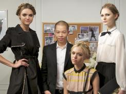Right on Target: Designer Jason Wu poses with three models styled in his creations for the capsule collection he's designed for Target. The line of women's clothes, handbags and scarves launches Feb. 5.