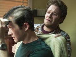 Joseph Gordon-Levitt, left, plays a young man dealing with a cancer diagnosis, and Seth Rogen is his best friend, in '50/50.'