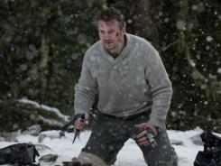 Cold, bloodied hero: Liam Neeson takes on a vicious pack of wolves in 'The Grey,' in theaters Friday.