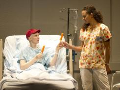 At her most vulnerable: Cynthia Nixon, left, plays a scholar suffering from ovarian cancer, and Carra Patterson is a kind nurse tending to her.
