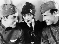 """Two pilots (Charles """"Buddy"""" Rogers, left, and Richard Arlen) are best friends who fall in love with the same girl (Clara Bow) during World War I."""