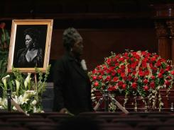 Singer Etta James' picture is seen next to her casket during her funeral on Saturday at Greater Bethany Community Church City of Refuge in Gardena, Calif.