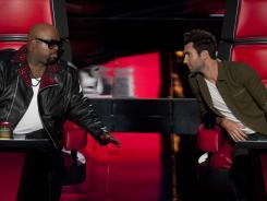 Judges Cee Lo Green, left, and Adam Levine compare notes during the 'Voice' auditioning process.