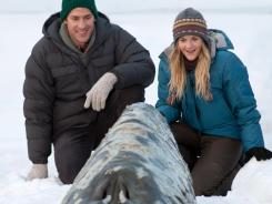 Reporter Adam Carlson (John Krasinski) and volunteer Rachel Kramer (Drew Barrymore) attempt to rescue a family of gray whales trapped in ice.