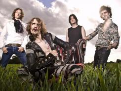 Dan Hawkins, left, Justin Hawkins, Ed Graham and Frankie Poullain of The Darkness.