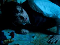 Post-Potter: Daniel Radcliffe continues to tackle the supernatural in 'The Woman in Black,' in theaters Friday.