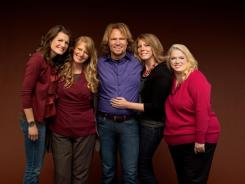 "Kody Brown, center, poses with his wives, from left, Robyn, Christine, Meri and Janelle in a promotional photo for the reality series, ""Sister Wives."""