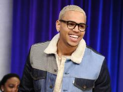 A source tells the Associated Press that Chris Brown will be performing at Sunday's Grammy Awards.