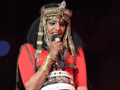M.I.A.'s hand signal during her Super Bowl performance of the new Madonna single was a switch from the handgun motion she uses in the video for the song.