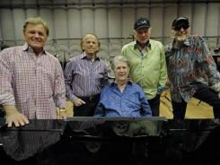 Back at the piano: Beach Boys' Bruce Johnston, left, Al Jardine, Brian Wilson, Mike Love and David Marks rehearse a medley of hits for Sunday's Grammy show.