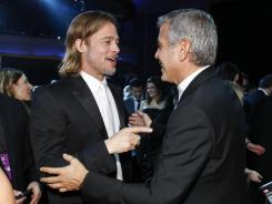 Brad Pitt and George Clooney are double nominees at this year's Oscars: Pitt is producer of the best-picture-nominated Moneyball and up for best actor for his role in the film. Clooney is nominated for best actor in The Descendants and for best screenplay in The Ides of March.
