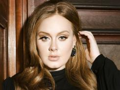 Adele had vocal cord microsurgery in November. She couldn't speak or sing during weeks of recovery.