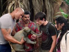 The elephant in the wood: Dwayne Johnson, left, Luis Guzman, Josh Hutcherson and Vanessa Hudgens encounter unusual creatures on the island.
