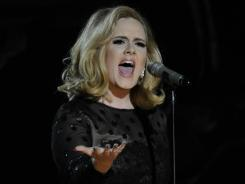 She's back: Adele's first major performance since vocal cord surgery had the industry crowd on their feet.