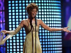 In this Sept. 15, 2004 photo, Whitney Houston performs at the World Music Awards at the Thomas and Mack Arena in Las Vegas.