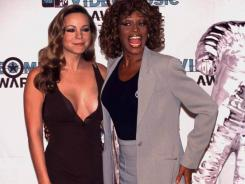 Mariah Carey, left, and Whitney Houston were at the top of their games at the MTV Awards in Los Angeles in September 1998.