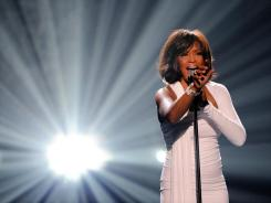 Whitney Houston accepts the Winner of International Favorite Artist Award at the 2009 American Music Awards.