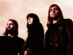 Matt Hayward, left, Emma Richardson and Russell Marsden of Band of Skulls