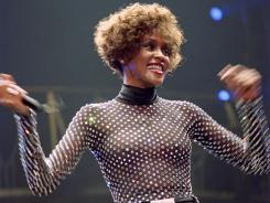 Whitney Houston performs in Paris in 1991. The singer was found dead Saturday.