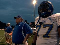 Coach Bill Courtney, left, and O.C. Brown in a scene from the Oscar-nominated documentary 'Undefeated.'