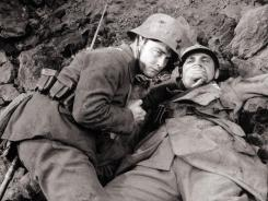 The 1930 masterpiece 'All Quiet on the Western Front,' starring Lew Ayres, left, brought the horrors of war home to movie audiences.