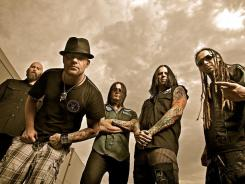 The band Five Finger Death Punch (Left to right: Chris Kael, Ivan Moody, Jason Hook, Jeremy Spencer, Zoltan Bathory).