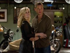 Torn between two guys: Tuck (Tom Hardy) uses his formidable skills to woo Lauren (Reese Witherspoon) in 'This Means War.'