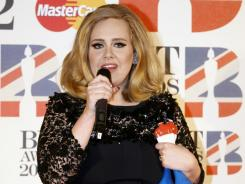 Adele, who picked up two trophies at Tuesday's Brit awards, sold a whopping 730,000 copies of '21' in the week after the Grammys.