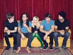 Five bandmates, one guitar: Walk Off the Earth's Joel Cassady, Gianni Luminati, Sarah Blackwood, Ryan Marshall and Mike Taylor play a guitar as one on 'Somebody That I Used to Know.'