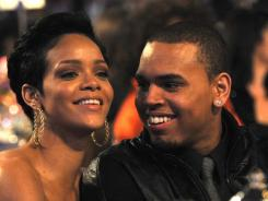 Rihanna and Chris Brown sat together at Clive Davis' 2009 pre-Grammys party. That night, Brown assaulted Rihanna, and he would be sentenced to five years of probation for the incident.