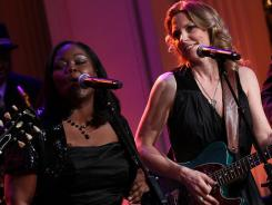 Shemekia Copeland, left, and Susan Tedeschi perform with an all-star cast. The tribute airs on PBS Monday.