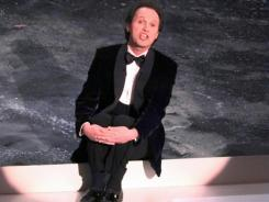 Billy Crystal takes a seat to sing at the opening of the 69th Academy Awards. If one Oscar bet is safe, it is probably that Crystal will be singing in his opening.