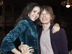 Mick Jagger and longtime girlfriend and designer L'Wren Scott made the scene at Fashion Week.