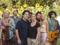 Don't worry, be hippie: Kerri Kenney-Silver, left foreground, Paul Rudd, Jennifer Aniston, Justin Theroux and Malin Akerman live the simple life in 'Wanderlust.'