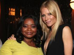 Octavia Spencer, left, and Gwyneth Paltrow strike a pose at the fifth annual Women In Film pre-Oscar cocktail party.
