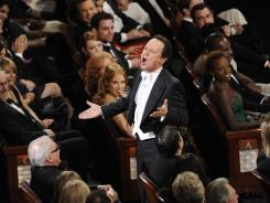 Oscar host Billy Crystal in the audience at the opening of the Academy Awards show.