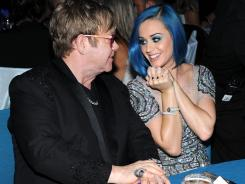 Host Elton John chats with Katy Perry.