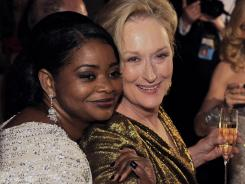The night's winning actresses Octavia Spencer, left, and Meryl Streep get cozy at the Governors Ball.