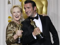 The Oscars, which gave trophies to Meryl Streep and Jean Dujardin, are typically the year's top-rated awards telecast but this year lost to CBS' Grammy Awards.