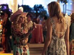 Leslie Bibb, right, stars as Amanda, a former mean girl who moves back home and must face the girls she bullied in high school, including Carlene (Kristin Chenoweth).