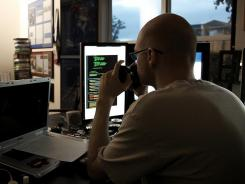 The code warrior: Tommy Refenes hard at work in 'Indie Game: The Movie.'