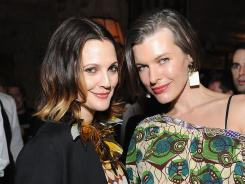 Let's do launch:  Actresses Drew Barrymore, left, and Milla Jovovich attend the Marni for H&M party  in Los Angeles.