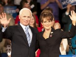 On the trail again:  Ed Harris is John McCain and Julianne Moore plays Sarah Palin in the adaptation of the best seller.