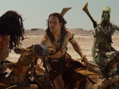 Dejah Thoris (Lynn Collins, left), John Carter (Taylor Kitsch) and Sola (Samantha Morton) traverse the Martian landscape in 'John Carter.'