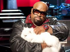 Animal magnetism: Cee Lo Green with Purrfect.