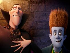 Dracula (voiced by Adam Sandler) attempts to shepherd diguised human Johnnystein (voiced by Andy Samberg) out of his resort for monsters in 'Hotel Transylvania.'