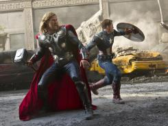 Power in numbers? Thor (Chris Hemsworth, left) and Captain America (Chris Evans) join forces to combat Loki in Marvel's 'The Avengers.'