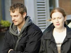 Joel Kinnaman and Mireille Enos play Seattle homicide detectives on the hunt for the murderer of a teenage girl in AMC's 'The Killing.'