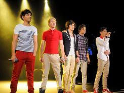 No. 1: Louis Tomlinson, left, Niall Horan, Harry Styles, Liam Payne and Zayn Malik of One Direction have the top-selling album in the country.