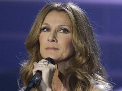 Celine Dion, shown during her opening night performance last year at Caesar's Palace in Las Vegas, says a virus caused an inflammation of her vocal cords.